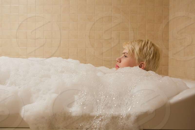 A woman and a hydro massage. She receives medical treatments for relaxation. photo