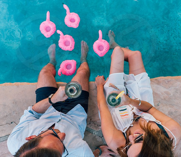 poolside pool flamingos floaties cocktail drink wine friends summer heat water california photo