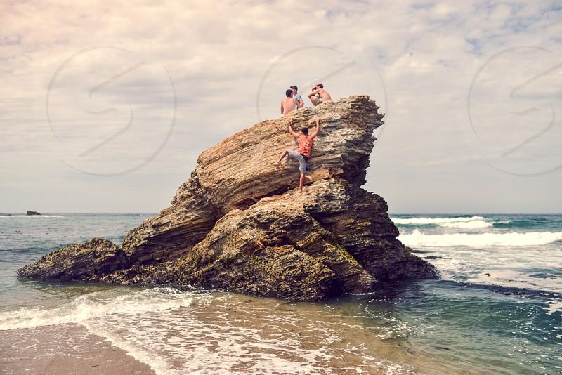 climb rock ocean friends outdoors photo