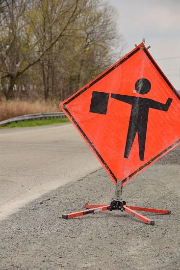yellow signage on asphalt road photo