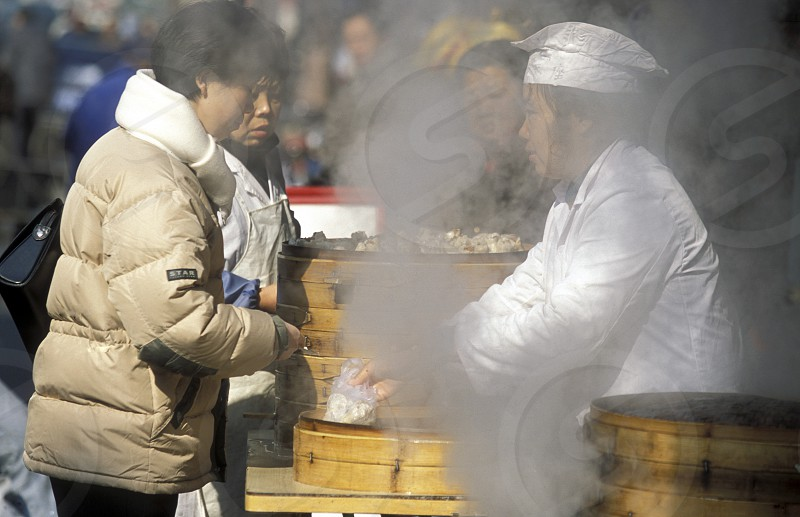 a chinese food stall in the City of Shanghai in china in east asia.  photo