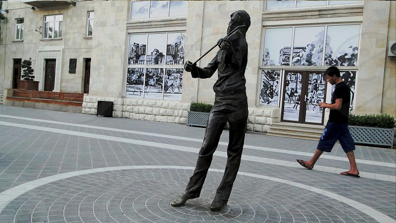 """Streets as they are. The violinist who plays Vivaldi's """"Four seasons"""" all the time .From a series of panorama Baku. photo"""