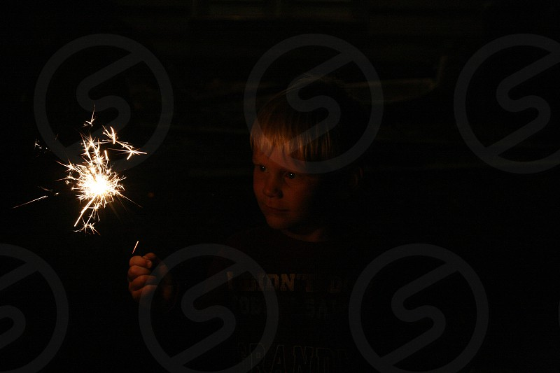 boy with sparkler photo