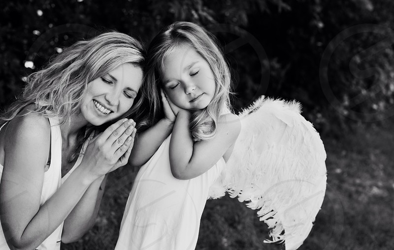 Two cute Angels mom and daughter baby girl street happy wings amazing love fly kid photo feelings  photo