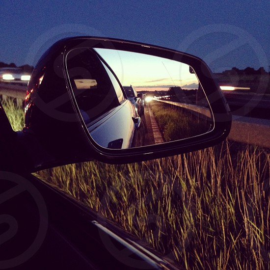 Stuck in traffic sun setting bmw 1 series photo