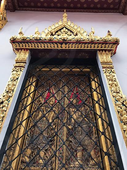 Outdoor day colour vertical portrait Grand Palace Bangkok Thailand Kingdom travel tourism tourist wanderlust gold gold leaf Buddhist Buddhism holy royal regal monarchy temple temples mosaic mirror tile tiles ornate shrine royal regal royalty photo