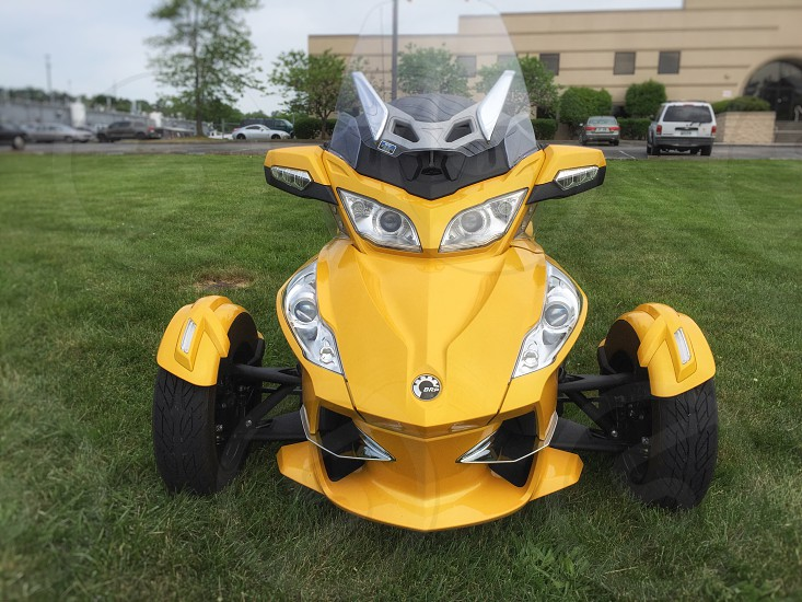 yellow and silver  tricycle on green field during daytime photo