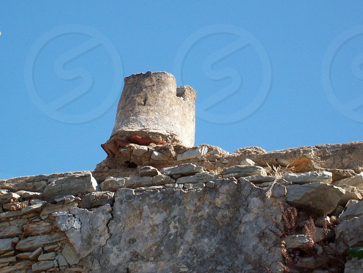 architecture - ruin - crumbling - decaying - chimney - solid fuel - heating - restoration - Greek - character - end of it's life - too far gone? - Greece photo