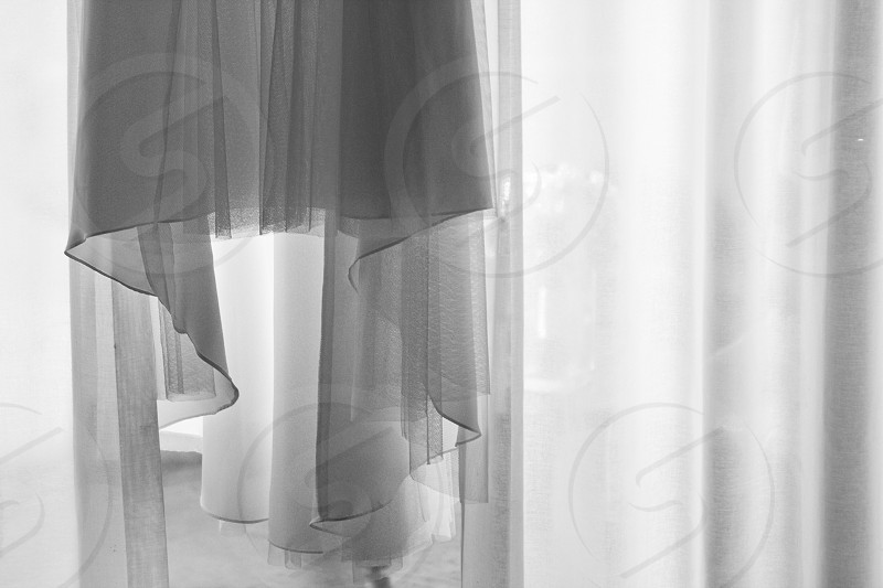 ruffled curtains in grayscale photography photo