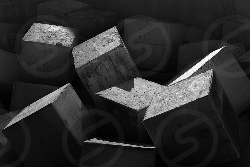 break water blocks in black and white photo