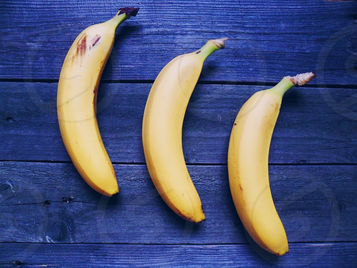 yellow bananas on brown wooden table photo
