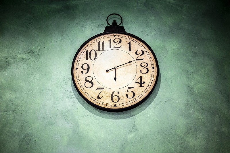 Old vintage watch with hanging on green wall  photo