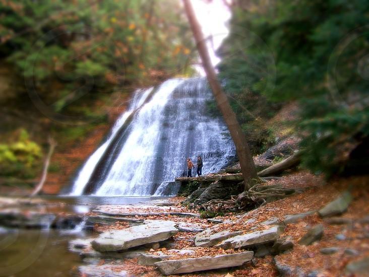 man and woman near a waterfall photo