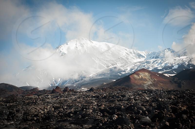 Russia landscape Kamchatka Tolbachik clinker volcano foothill aloft up summit photo