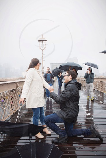 Rainy Saturday Proposal on the Brooklyn Bridge photo