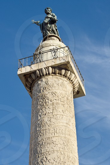 Trajan's Column in Rome.  Originally there was a statue of Trajan at the top but it disappeared during the Middle Ages.  In 1587 Pope Sixtus V replaced it with a statue of Saint Peter. photo