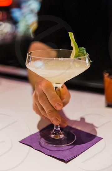 Bartender serves cocktails at an upscale bar photo