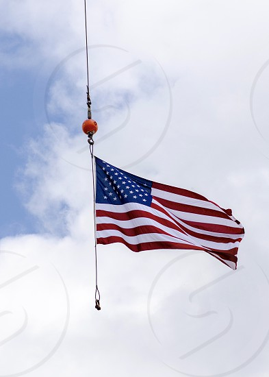 American flag flying from crane  photo