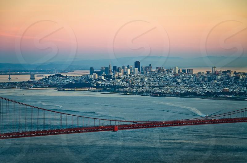 Night scene of San Francisco skyline with Golden Gate Bridge on the foreground photo