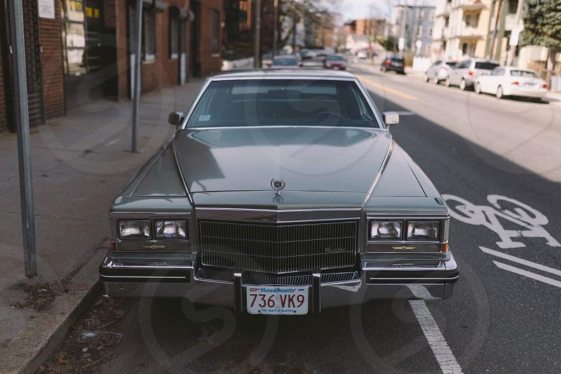 Cadillacclassicvintageoldiecarsmint conditioncleangrillheadlightsparkedcar  photo