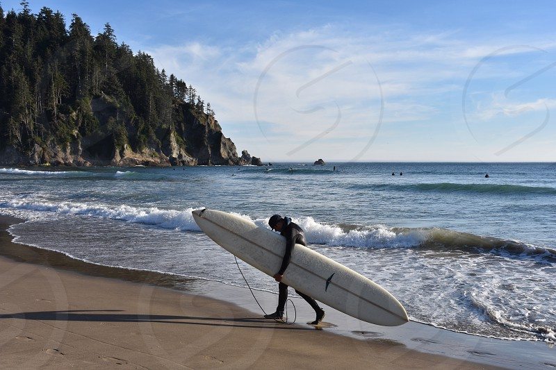 Surfer walking waves ocean  beach  photo
