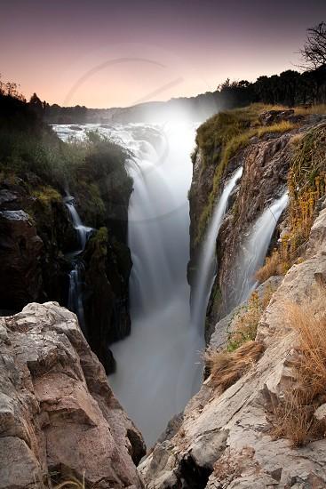 Epupa falls. Long exposure of a waterfall. photo