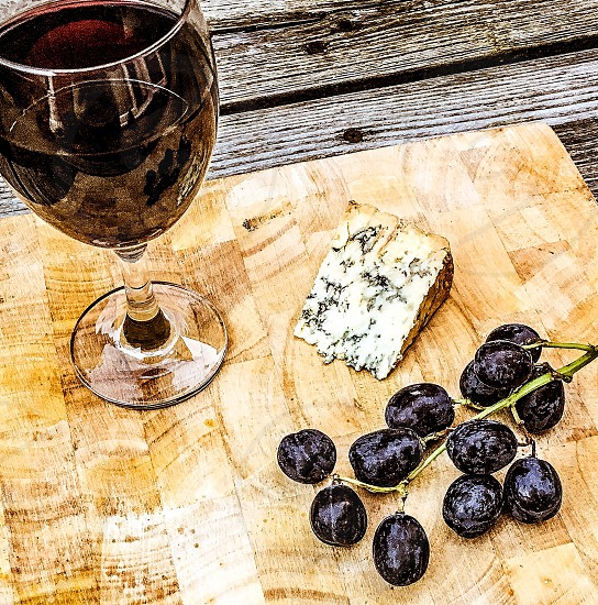 Wine red blue cheese Stilton food drink grapes glass knife meal slice block wood photo