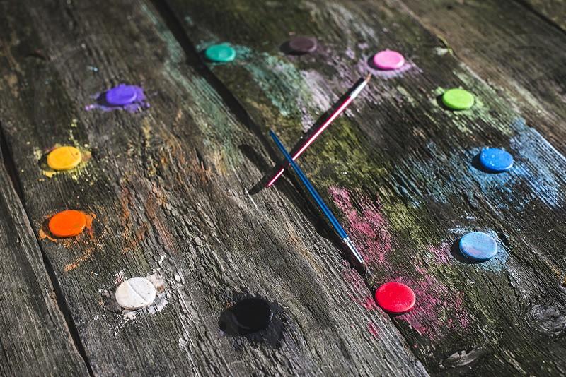 Watercolor paints in clock shape photo