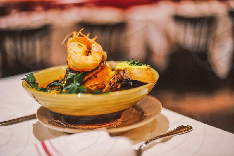 steamed shrimp in a yellow bowl on a table photo