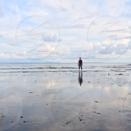 person standing on seashore photo