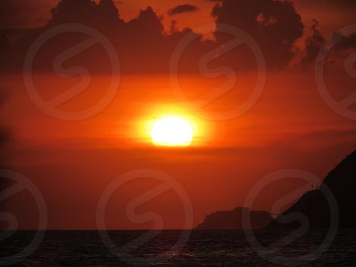 rippling ocean water during sunset photo