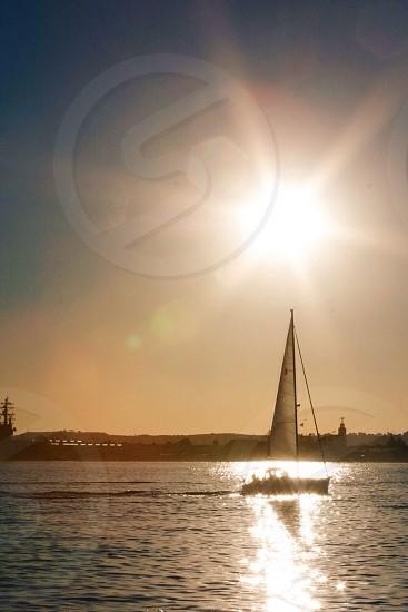 white sail boat photo