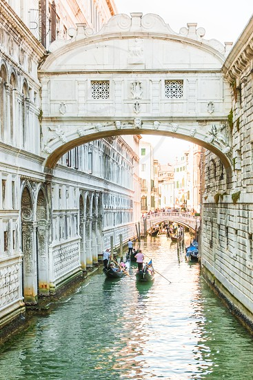 Gondola Rides At The Famous Bridge Of Sighs In Venice Italy photo