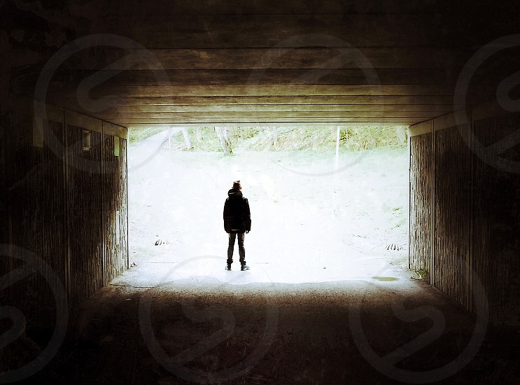 Boy in a tunnel of light photo