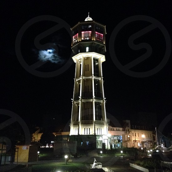 Tower night moon photo