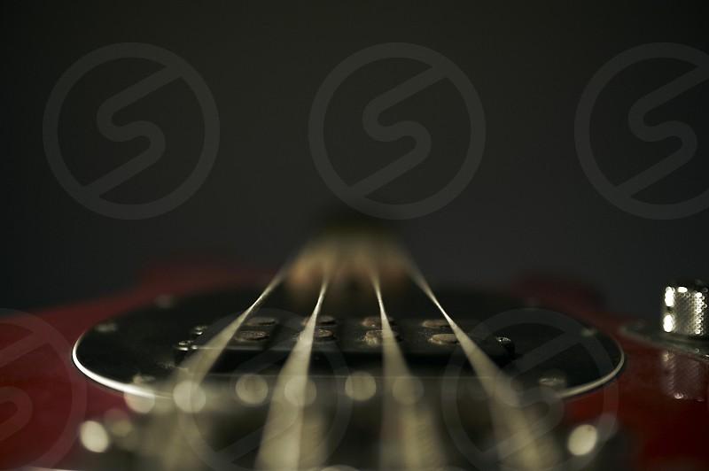 Macro close up shot of a Musicman Stingray bass down the neck photo