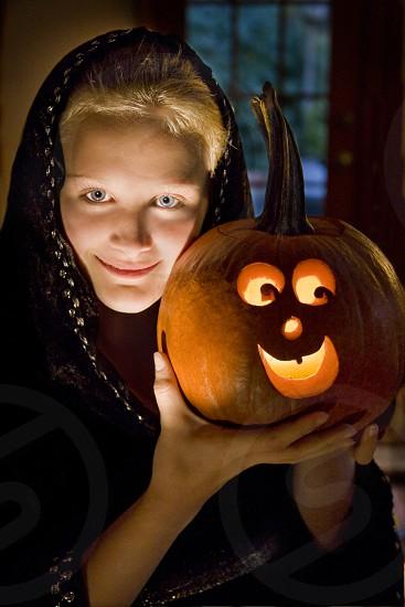 woman holding pumpkin photo