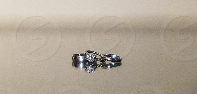 silver ring band with solitaire diamond stone photo