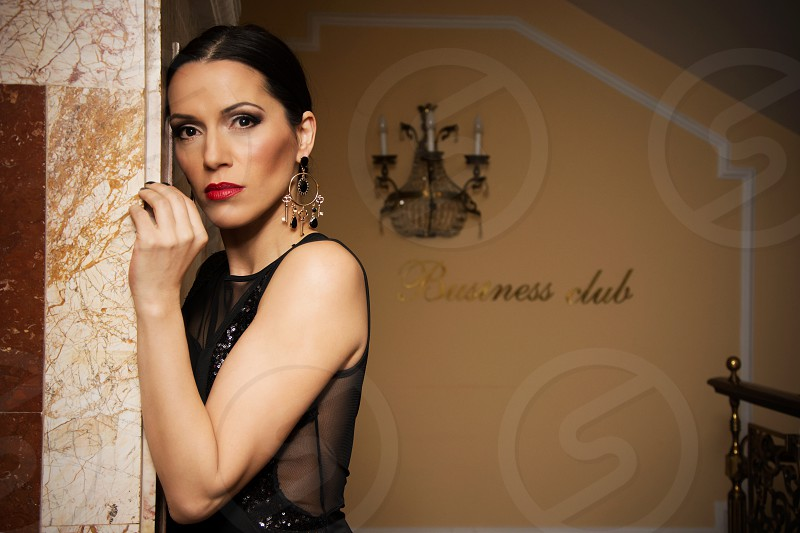 Elegant woman in black dress at the business club photo