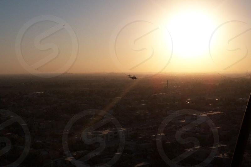 sun rising over gray brown city-scape photo