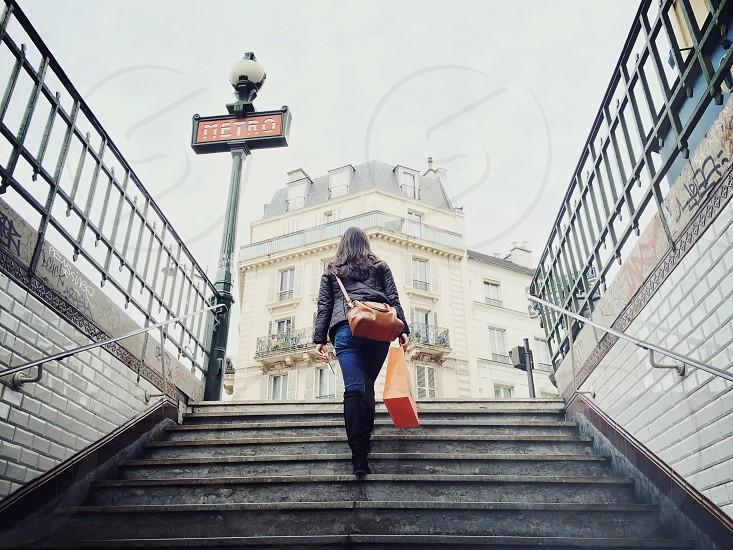 Shopping metro subway Paris travel woman tourist chic emerging underground stairs photo