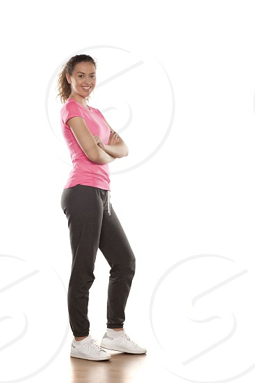 happy young woman in sportswear on a white background photo