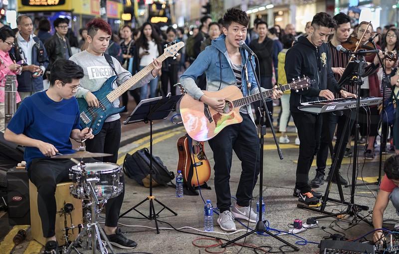 Hongkong wanchai street life music band people city asia evening night photo
