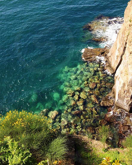 green rocky cliff view photo