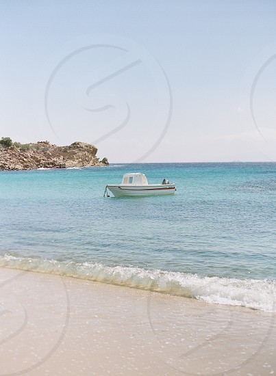 boat ocean water small boat salt water blue beachisland islands photo