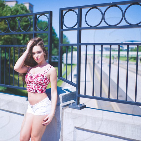 woman in pink floral white crop top and white shorts photo