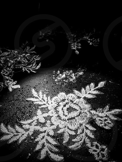 Indoor day portrait vertical black and white monochrome Embroidery sewing sew lace sequins beads bead beading shiny sparkly sparkling light dark shadow spotlight wedding preparation marriage home made homemade dress tailor dressmaking dressmaker delicate pretty dainty photo