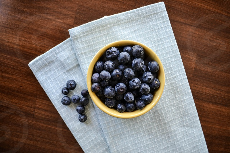 Blueberries and yellow bowl photo