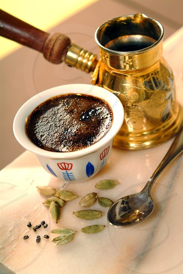 caffe with cardamom. In some Arab countries added before grinding coffee spices cardamom photo