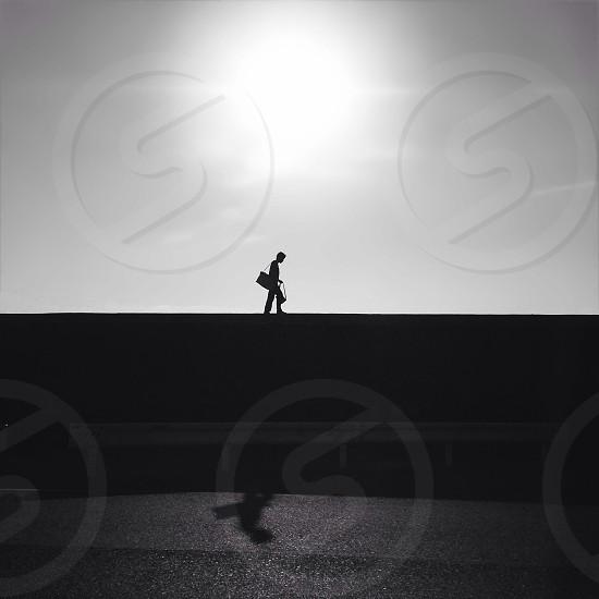 man in black sling bag walking photo